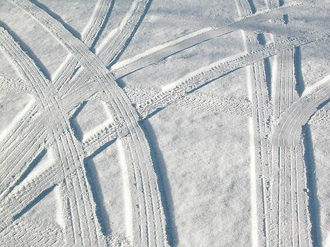 Snow and car tracks by Rob Huntley
