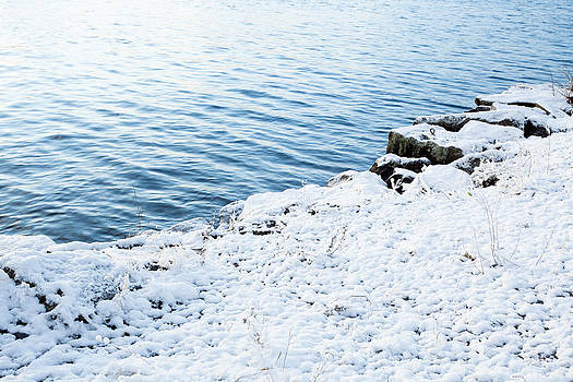 Snow and water peaceful and clear by Juhani Viitanen