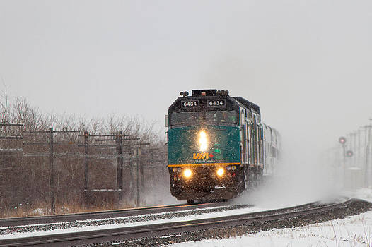 Passenger Train Blowing Snow on Curve by Steve Boyko