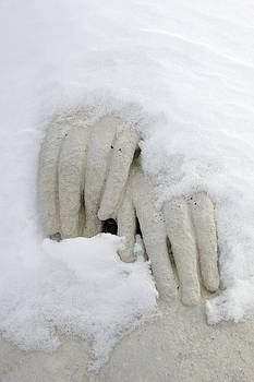 Snow covered hands of a statue by Matthias Hauser