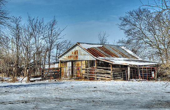 Snow on a Rusty Barn by Lisa Moore