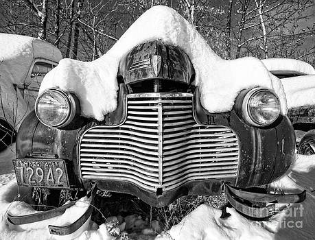 Edward Fielding - Snowed In a thick blanket of snow covering a vintage Chevy