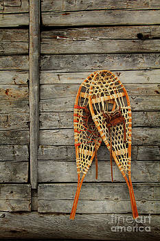 Snowshoes on wall by Isabel Poulin