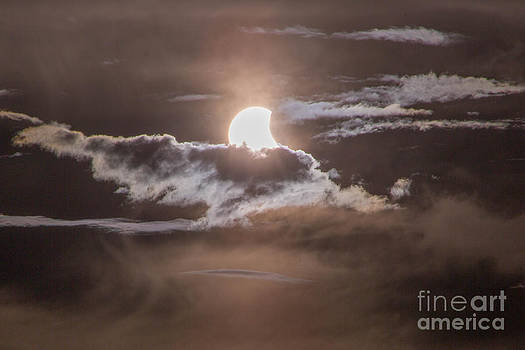 Solar Eclipse with Clouds by Kimberly Blom-Roemer