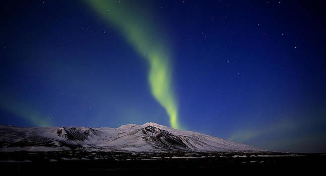 Solarstorm over glacier by Stefan  Gudmundsson