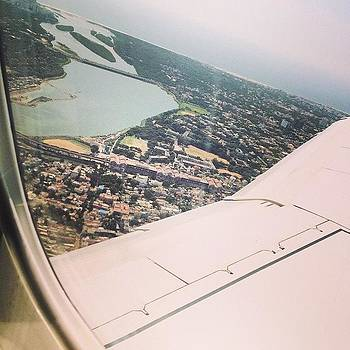 Sometimes You Look Out Of Plane Windows by Srivatsa Ray