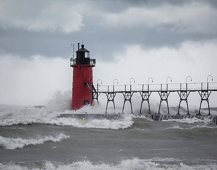 South Haven Pier Light in a Storm by Kimberly Kotzian