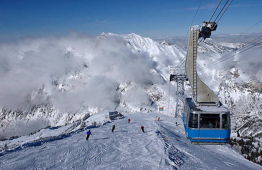 Spectacular view to the mountains and blue ski tram at Snowbird ski resort in Utah by Anton Oparin