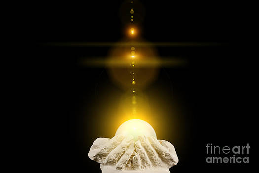 Simon Bratt Photography LRPS - Spiritual healing light in cupped hands on black