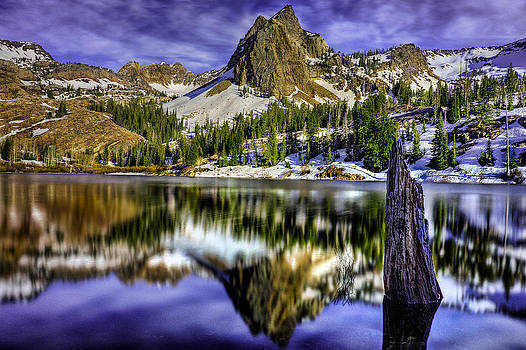 Spring time mountain lake by Kevin Rowe