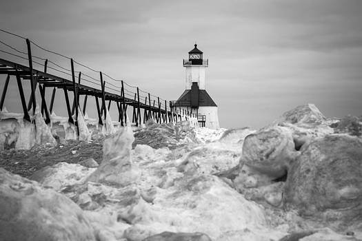 St. Joseph Lighthouse in ice field by Kimberly Kotzian
