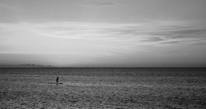Stand Up Paddle Surfer In Kauai Channel At Sunset Black and White by Gregory Schultz