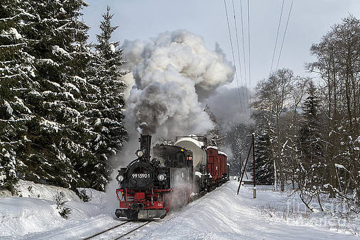 Steam train in wintery forrest by Christian Spiller