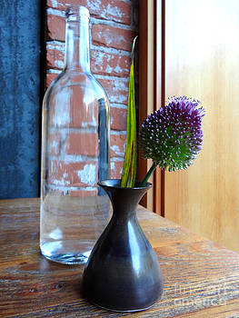 Still-life of a bottle and a flower in a vase by Martina Roth