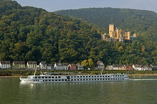 Stolzenfels Castle with passing cruise ship Switzerland on the Rhine Germany by David Davies