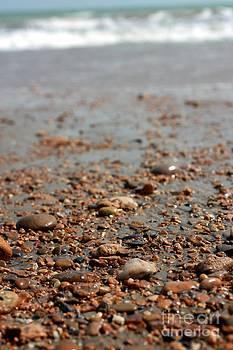 Stones and waves at beach  by Muhammad Junaid Rashid