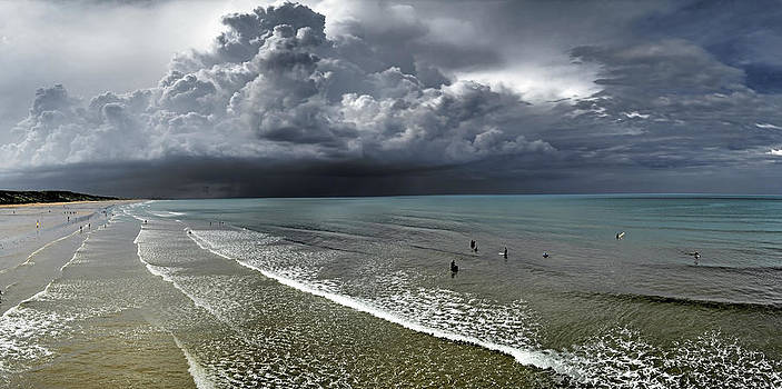 Storm and Surfers by Tony Partington