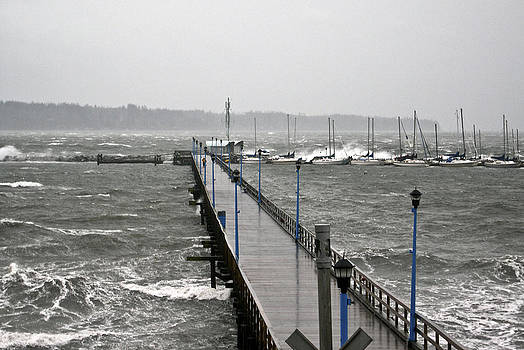 Storm at the pier. by D Laird Allan