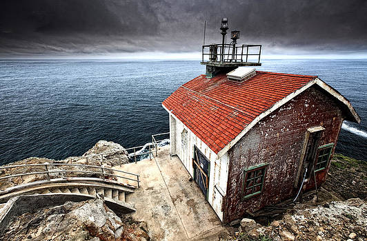 Storm clouds over Point Reyes Lighthouse Shack by Laszlo Rekasi