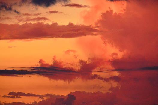 Storm clouds sun set by Duane King