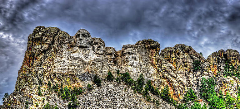 Stormy skies over Mt Rushmore by Jim Boardman