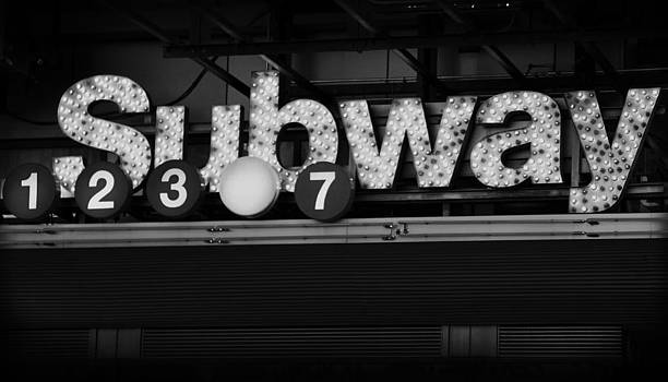 Subway Sign in Time Square by Donna Betancourt
