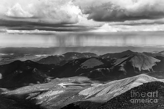 Sun and Rain on Pikes Peak by CJ Benson