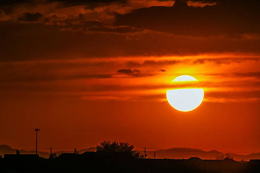 Sun Ball Hanging from Clouds by Kirk Strickland