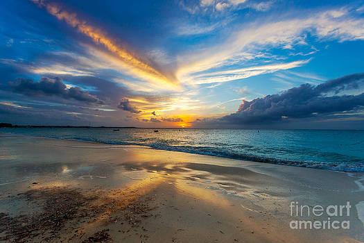 Jo Ann Snover - Sun dips below horizon on Grace Bay Beach
