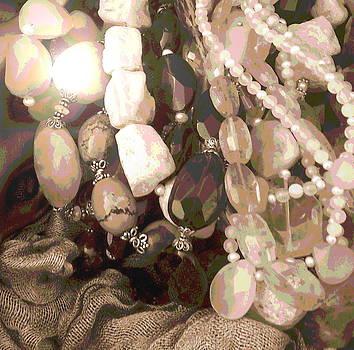 Sun Glinting on Beautifullly Strung Beads by Zeni Shariff