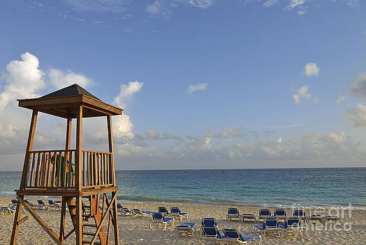 Sun lounger on tropical beach at sunrise by Sami Sarkis