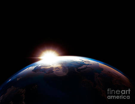 Sun rising from behind planet Earth outline by Oleksiy Maksymenko