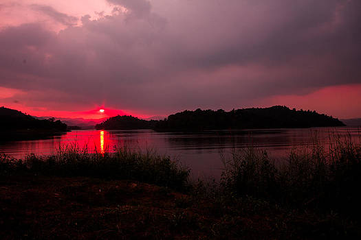 Sun Setting Down The Hill by Nattapong Chinsuwan