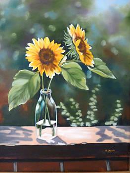 Sunflowers in a bottle by Reta Haube