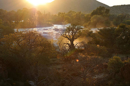 Sunrise at the Epupa waterfall in Namibia by Grobler Du Preez