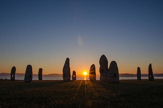 Sunrise between menhirs by Abel Rodriguez