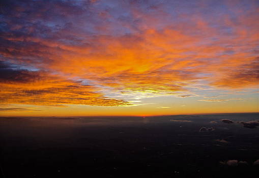 Sunrise from the airplane by Jennifer Lamanca Kaufman
