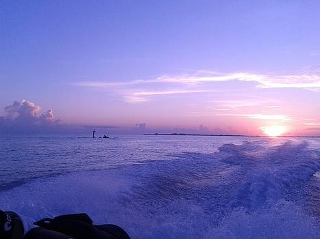 Sunrise from the boat by Liz Rosales