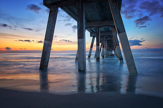 Sunrise from under Johnnie Mercer's Pier Wrightsville Beach NC by Craig Bowman