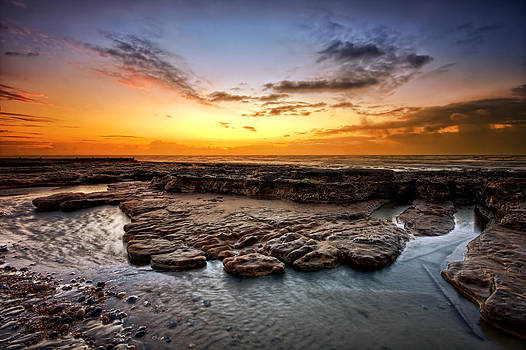 Sunrise on Bexhill beach by Mark Leader