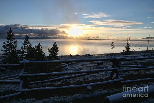 Sunrise on Yellowstone lake by Edward R Wisell