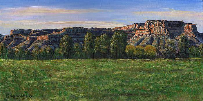 Sunrise over Farmington bluffs by Timithy L Gordon