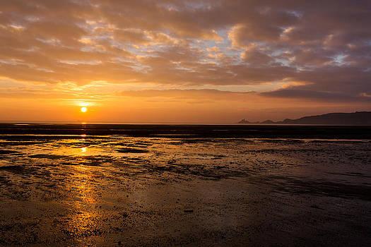 Sunrise over Mumbles mudflats by Paul Cowan