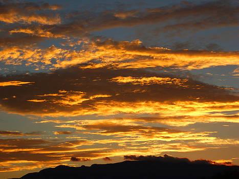 Sunrise over Sandia Mountains by Shirin McArthur