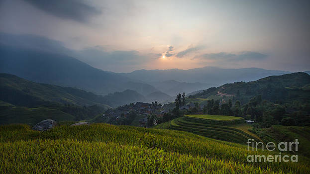 Sunrise over the Dragon's Backbone Rice Terraces by Immanuel Vinikas