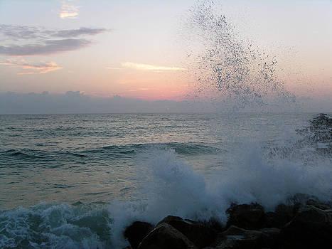 Sunrise with crashing waves by Julianne Felton