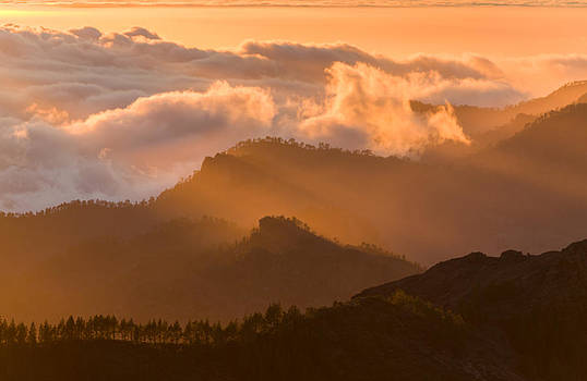 Sunset above the clouds by Johan Elzenga