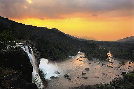 Sunset At Athirappally Waterfall In Kerala South India by Pradeep Subramanian