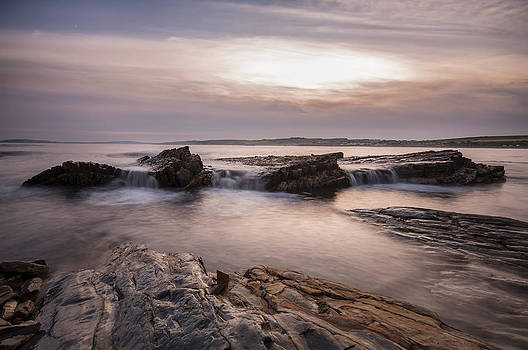 Sunset at Garretstown beach by M I