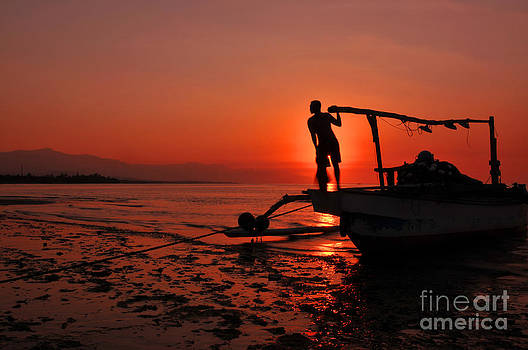 Sunset at Lovina Beach by Wayan Suantara